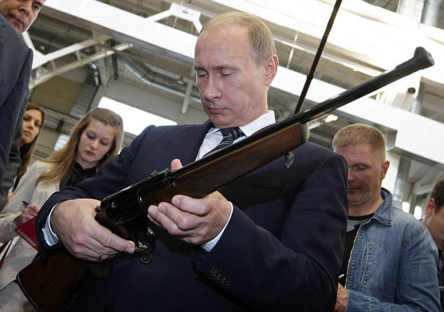 Picture taken on September 14, 2009 shows Russian Prime Minister Vladimir Putin examining a rifle during a visit to a weapons manufacturing facility in Tula. Putin made a routine working visit to the town and surrounding region.                     AFP PHOTO / RIA NOVOSTI / POOL / ALEXEY DRUZHININ (Photo credit should read ALEXEY DRUZHININ/AFP/Getty Images)